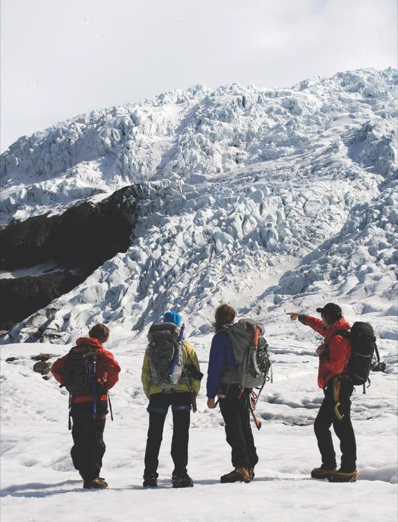 four-people-on-glacier-hike