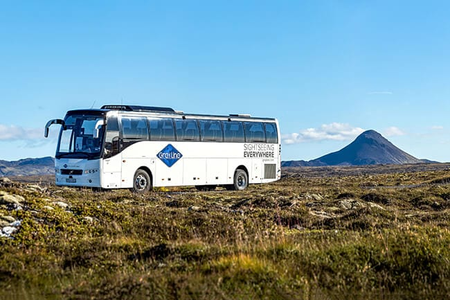 Gray-Line-airport-shuttle-bus-and-Keilir-mountain.jpg