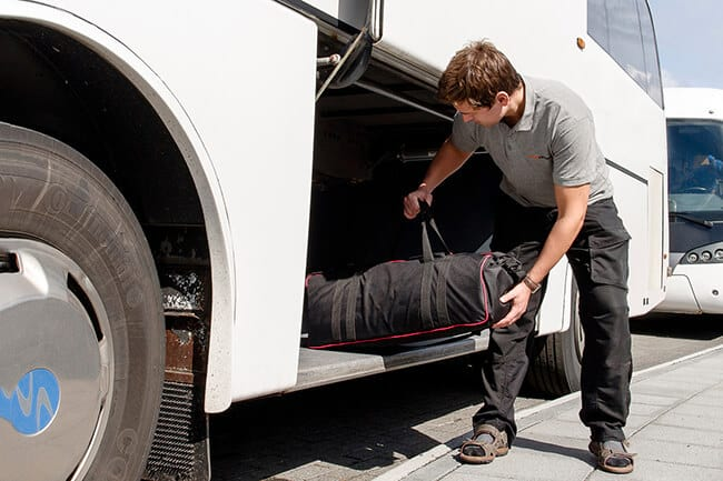 Gray-Line-bus-driver-helping-with-luggage.jpg
