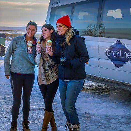 Three women holding ice cream cones