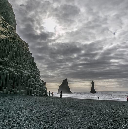 Reynisdrángar rock formation and black sand beach