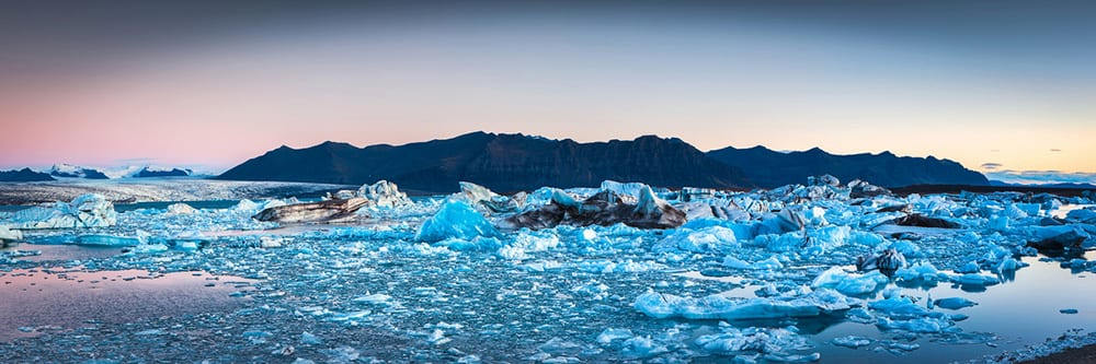 Jokulsarlon Glacier Lagoon at Sunset filled with icebergs Iceland