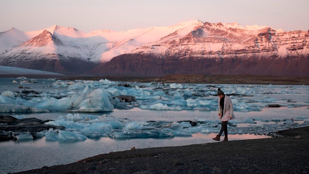 Walking around Jokulsarlon Glacier Lagoon at sunset south Iceland