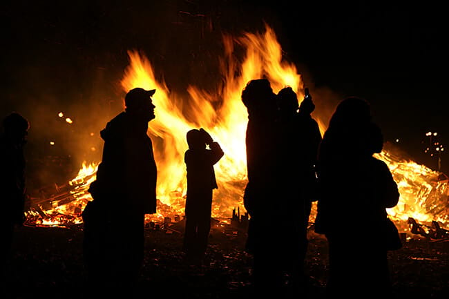New Years-Eve-crowd-enjoying-bonfire-Iceland.jpg
