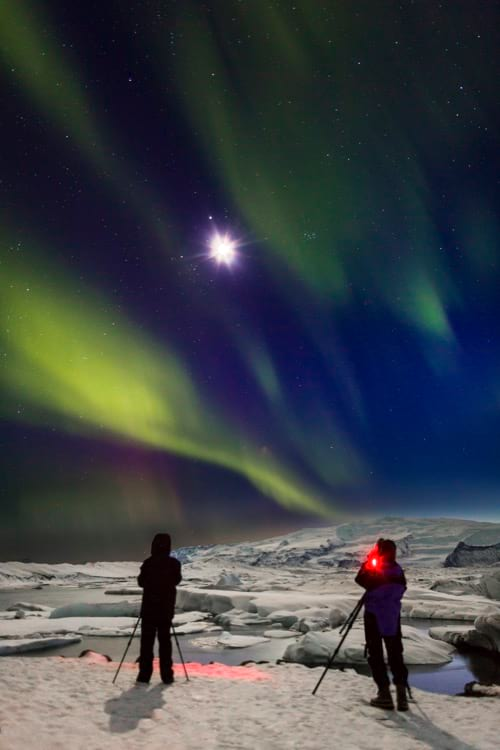 northern-lights-with-moonlight-and-snow-covered-landscape