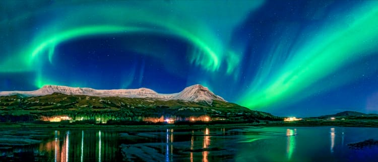 northern-lights-over-snow-capped mountains