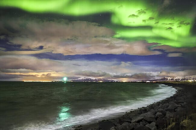 Northern-lights-ocean-shore-Iceland