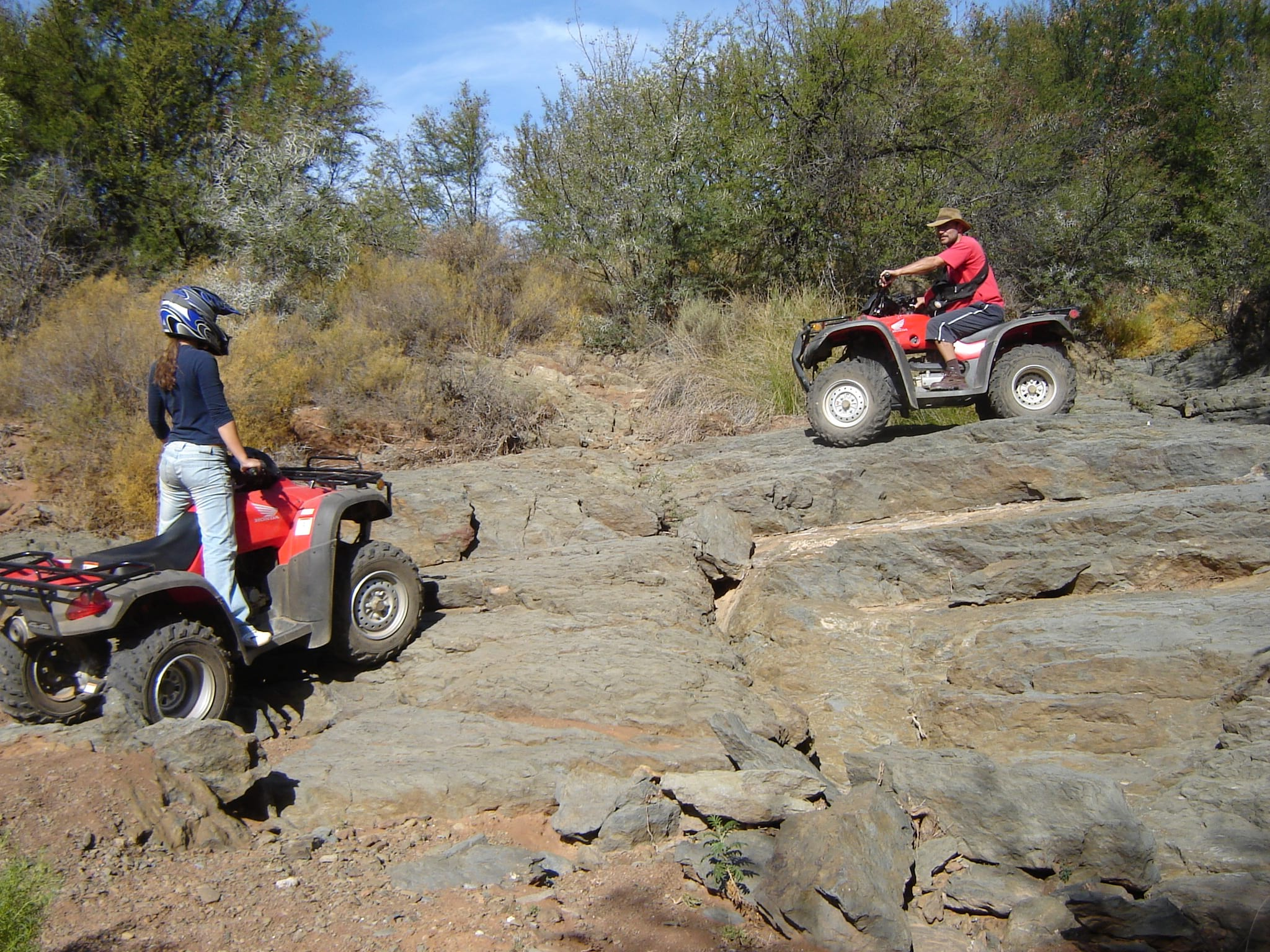 Teenager Beth and her dad on quad bikes