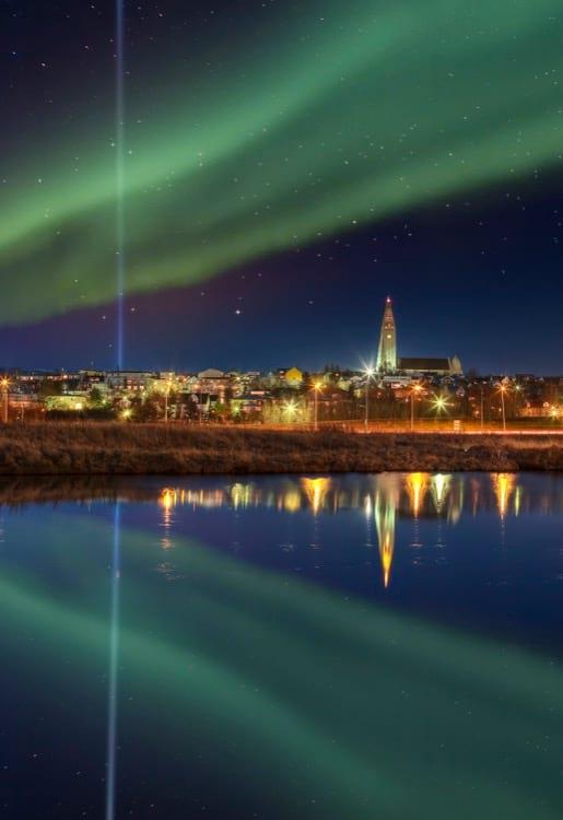 northern-lights-over-skyline-of-reykjavik