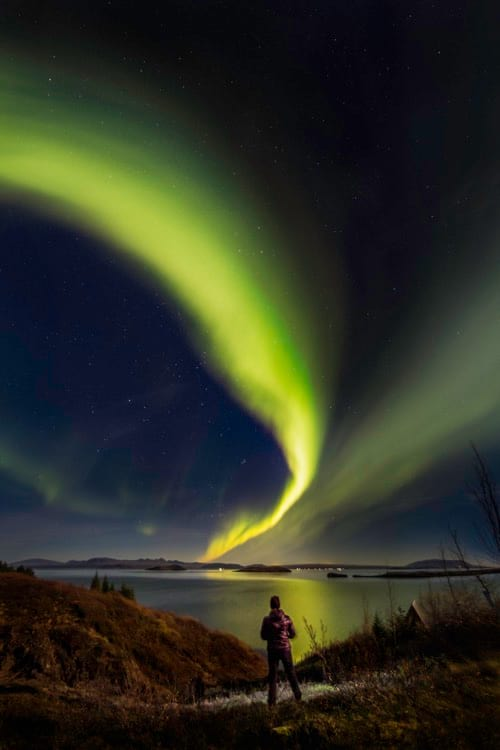 green-northern-lights-over-a-lake