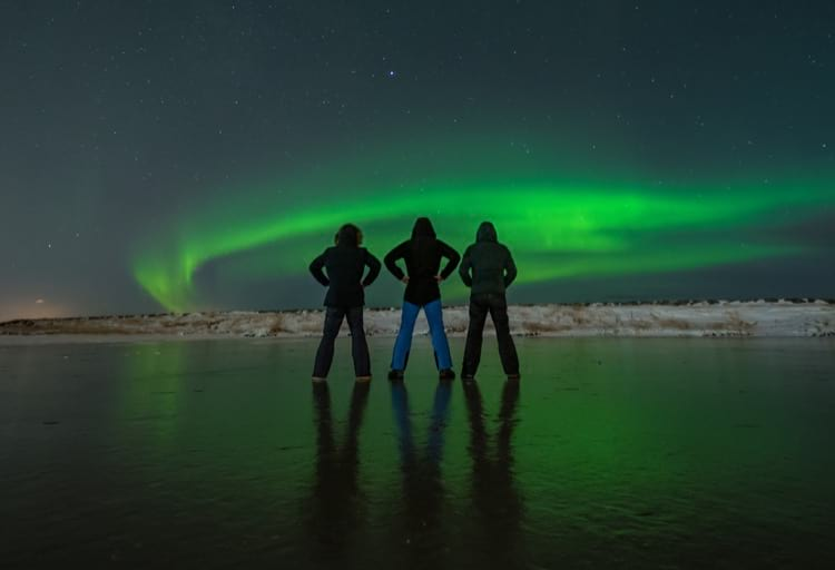 three-friends-watching-northern-lights