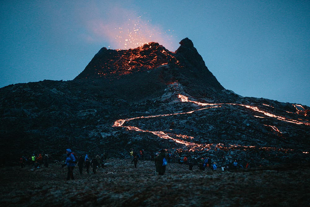 Visitors at Fagradalsfjall volcano eruption site in the evening Iceland