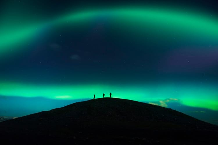 Watching the aurora borealis from the top of the mountain